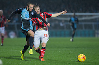 Michael Harriman of Wycombe Wanderers & Laurence Wilson of Morecambe  battle for the ball during the Sky Bet League 2 match between Wycombe Wanderers and Morecambe at Adams Park, High Wycombe, England on 2 January 2016. Photo by Andy Rowland / PRiME Media Images