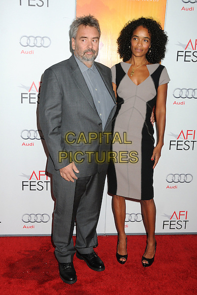 "Luc Besson and Virginie Besson-Silla.AFI Fest 2011 Gala Screening of ""The Lady"" held at Grauman's Chinese Theatre, Hollywood, California, USA..November 4th, 2011.full length grey gray suit dress black married husband wife beard facial hair .CAP/ADM/BP.©Byron Purvis/AdMedia/Capital Pictures."