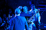 BROOKLYN  -- MARCH 08, 2011:  Soulive's Eric Krasno (L), Neil Evans (C) and Alan Evens (R), hug John Scofield after finishing a set at Brooklyn Bowl on March 08, 2011 in Brooklyn.  (PHOTOGRAPHS BY MICHAEL NAGLE)
