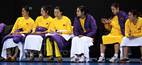23 NOV 2011 - LONDON, GBR - Chinese players wait on the bench during the 2011 London Handball Cup match against Slovakia at The Handball Arena in the Olympic Park in Stratford, London .(PHOTO (C) NIGEL FARROW)