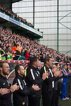 Home team manager Alan Stubbs joining in a minute's applause at Easter Road stadium before the kick-off in the Scottish Championship match between Hibernian and visitors Alloa Athletic. The home team won the game by 3-0, watched by a crowd of 7,774. It was the Edinburgh club's second season in the second tier of Scottish football following their relegation from the Premiership in 2013-14.