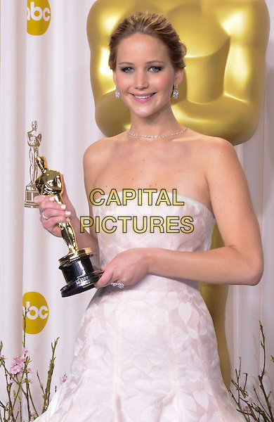 Jennifer Lawrence (wearing Dior Haute Couture).85th Annual Academy Awards held at the Dolby Theatre at Hollywood & Highland Center, Hollywood, California, USA..February 24th, 2013.pressroom oscars half length white pale pink strapless dress gown voluminous award trophy winner .CAP/ADM/RE.©Russ Elliot/AdMedia/Capital Pictures.