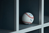 A Perfect Game Rawlings baseball sits in a cubby in the dugout during the Atlantic Coast Prospect Showcase hosted by Perfect Game at Truist Point on August 22, 2020 in High Point, NC. (Brian Westerholt/Four Seam Images)