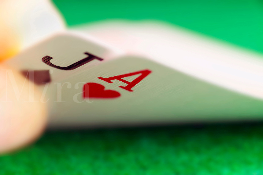 Close up of a 21 hand with jack of spades and ace of hearts in a poker card game