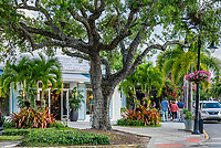 Charming shops along 3rd street in Old Naples, Florida, USA.