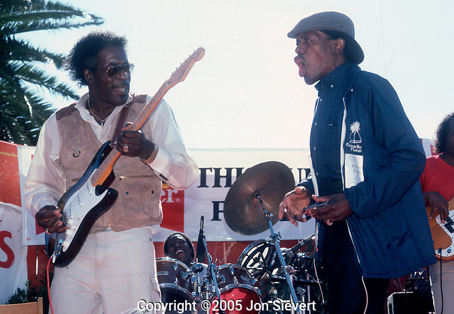 Buddy Guy and Jr. Wells. Sept 1986. American blues guitarist and singer. Known as an inspiration to Jimi Hendrix, Angus Young, Eric Clapton, Ace Frehley, Jimmy Page, Stevie Ray Vaughan, and many other guitarists, Guy is considered an important exponent of Chicago blues. <br /> <br /> Junior Wells worked with Guy in the 1960s and recorded his first album, Hoodoo Man Blues for Delmark Records. Wells and Guy supported the Rolling Stones on numerous occasions in the 1970s. This was a relatively rare one-shot reunion in 1986.