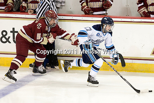 Alex Carpenter (BC - 5), Jennifer More (Maine - 17) - The visiting University of Maine Black Bears defeated the Boston College Eagles 5-2 on Sunday, October 30, 2011, at Kelley Rink in Conte Forum in Chestnut Hill, Massachusetts.