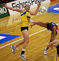 Pulse captain Cushla Lichtwark collides with Temepara George during the ANZ Netball Championship match between the Central Pulse and Northern Mystics, TSB Bank Arena, Wellington, New Zealand on Monday, 4 May 2009. Photo: Dave Lintott / lintottphoto.co.nz