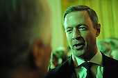 Washington, DC - March 17, 2009 -- Governor Martin O'Malley (Democrat of Maryland) is pictured at the annual St. Patrick's Day reception in the East Room of the White House in Washington, DC, USA on Tuesday, 17 March 2009. The room was lit with green lights for the occasion. .Credit: Matthew Cavanaugh - Pool via CNP