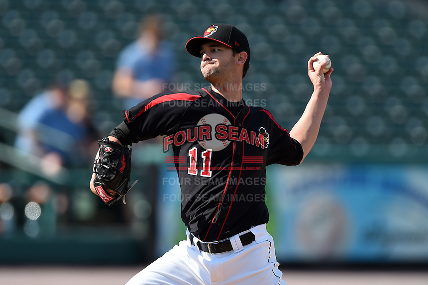 Rochester Red Wings pitcher Kris Johnson (11) delivers a pitch during the first game of a doubleheader against the Buffalo Bisons on July 6, 2014 at Frontier Field in Rochester, New  York.  Rochester defeated Buffalo 6-1.  (Mike Janes/Four Seam Images)