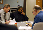 Unidentified editors in a News Meeting, at Newsday in Melville on Thursday december 23, 2004. (Photo / Jim Peppler).