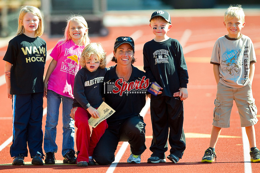 Wake Forest Demon Deacons head coach Jennifer Averill poses for a photo with a group of young Wake Forest Demon Deacon fans following the game against the Virginia Cavaliers at Kentner Stadium October 22, 2011, in Winston-Salem, North Carolina.  The Demon Deacons defeated the Cavaliers 5-0..  Photo by Brian Westerholt / Sports On Film