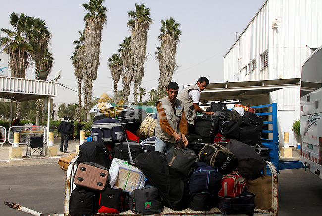Palestinians returning from Egypt cross through the Rafah crossing on Feb. 19, 2011. The Egyptian authorities reopened the Rafah crossing on its border with the Gaza Stripe on Friday, the first time after the resignation of President Hosni Mubarak. Photo by Ashraf Amra