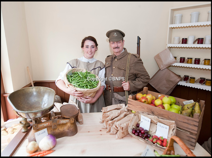 BNPS.co.uk (01202 558833)<br /> Pic: PhilYeomans/BNPS<br /> <br /> Re-Open All Hours...<br /> <br /> The re-built edwardian greengrocers shop with Gertrude and William re-created by actors in period costume.<br /> <br /> A greengrocers shop in a Victorian two up two down has been reunited with the family that once owned it after it was painstakingly rebuilt at the Black Country Living Museum in Dudley.<br /> <br /> The turn-of-the-century greengrocers shop has re-opened for business almost a 100 years after it served its first customers - and it is an exact replica of how it used to be.<br /> <br /> Plucky housewife Gertrude Adey transformed her modest front room into a fruit and veg shop in 1916 to earn a few shillings so she could survive while husband William was off fighting in the First World War.<br /> <br /> In 1995 the historic building was demolished to pave the way for a new development in the town centre but 98 years after it first opened the shop is back in business after it was lovingly rebuilt brick by brick.<br /> <br /> The humble shop will only sell produce that was available at the time and any left over fruit and veg will be turned into pickles, chutneys and jams, just like it would have been back in the early 20th century.<br /> <br /> And staff will even be dressed in plain period clothing just as William and Gertrude would have worn. <br /> <br /> The opening of the time-warp shop is the culmination of a project by local historians who rebuilt the shop in the grounds of the Black Country Living open air museum.<br /> <br /> Three generations of the Adey family - William's grandson Jim, 85, great grandson Andrew, 54, and great-great granddaughter Melanie, 22 - officially opened the shop on Saturday.