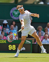 England, London, Juli 04, 2015, Tennis, Wimbledon, Roger Federer (SUI) in action against Groth (AUS)<br /> Photo: Tennisimages/Henk Koster