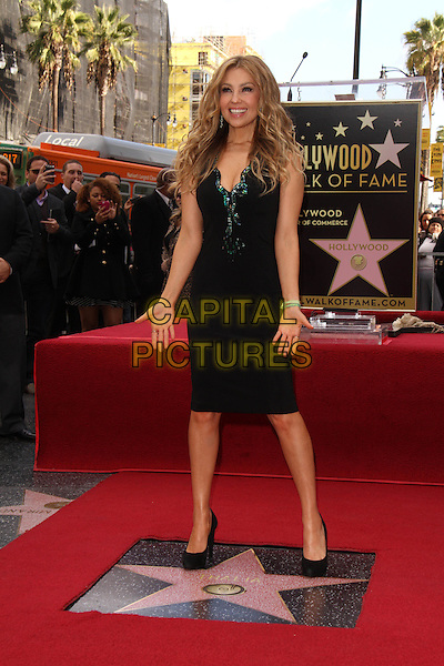 HOLLYWOOD, CA - DECEMBER 05: Thalia (Ariadna Thalia Sodi Miranda) Honored On The Hollywood Walk Of Fame on December 5, 2013 in Hollywood, California.<br /> CAP/MPI/JO<br /> &copy;Janice Ogata/MediaPunch/Capital Pictures