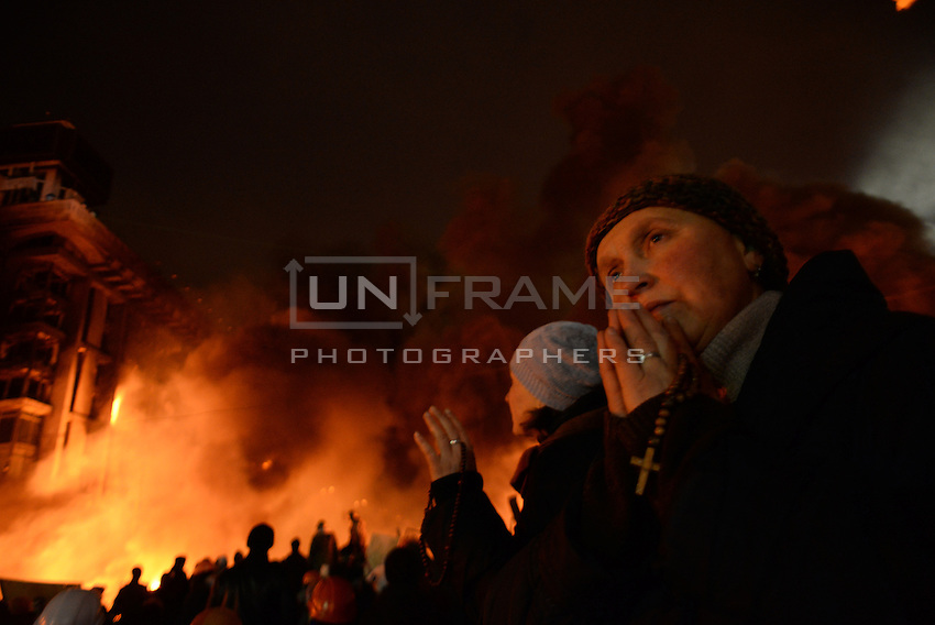 A protester prays holding a rosary. Many Orthodox faithful participated in the most intense moments of the battle with traditional orthodox choirs in the middle of the  battlefield of Maidan square.  Kiev, Ukraine