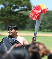 NWA Democrat-Gazette/J.T. WAMPLER Erik Garcia holds a torch for his team Thursday June 15, 2017 during LIFE Olympics at Northwest Arkansas Community CollegeÕs LIFE program. Students in the program come from the Bentonville, Fayetteville, Gentry, Pea Ridge, Rogers and Springdale districts. The three-day program informs local high school students about the process of getting into and being successful in college. Garcia is a student at NWACC.