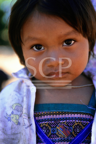 Mato Grosso, Brazil. Young Rikbaktsa (Canoeiro) Indian girl.