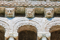 13th century Romanesque  reilief sculptures depicting monsters and mythical animals on the loggia corbels of the  8th century Romanesque Basilica church of St Peters, Tuscania, Lazio, Italy