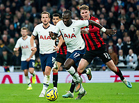 Tottenham Hotspur's Moussa Sissoko holds off the challenge from Bournemouth's Jack Stacey<br /> <br /> Photographer Stephanie Meek/CameraSport<br /> <br /> The Premier League - Tottenham Hotspur v Bournemouth - Saturday 30th November 2019 - Tottenham Hotspur Stadium - London<br /> <br /> World Copyright © 2019 CameraSport. All rights reserved. 43 Linden Ave. Countesthorpe. Leicester. England. LE8 5PG - Tel: +44 (0) 116 277 4147 - admin@camerasport.com - www.camerasport.com