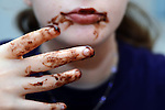 Girl with messy hands and face with chocolate