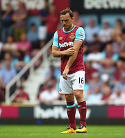 Mark Noble of West Ham United dejected   during the Barclays Premier League match between West Ham United and Swansea City  played at Boleyn Ground , London on 7th May 2016