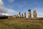 Chile, Easter Island: Array of statues or moai on a platform or ahu at Ahu Tongariki, near the quarry Rano Raruku.  This is the largest array of moia on Easter Island, consisting of 15 moai..Photo #: ch240-33841.Photo copyright Lee Foster www.fostertravel.com lee@fostertravel.com 510-549-2202
