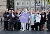 NO REPRO FEE. 18/10/2011. Cross partyTDs  to put aside party differences for Alzheimers. Cross party elected officials will join forces with a giant purple post it character outside the gates of Dail Eireann to remind elected officials to sign up to the Alzheimer Pledge to bring in a National Dementia Strategy for Ireland. Pictured are John Carey, Jerry Buttimer TD Fine Gael, Dominic O Suilleabhan, Phillis Brochert, Anna Crey, Marilyn Sheehan, Richard Dolan, Anne Healy, Muriel Banks, TD Ivana Batchik, Noirin Walsh Caroline Kitty and Maurice O Connell. Picture James Horan/Collins Photos