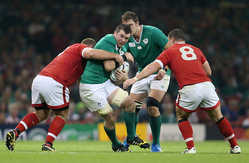 Ireland's Peter O'Mahony is tackled by Canada's Doug Wooldridge<br /> <br /> Photographer Ian Cook/CameraSport<br /> <br /> Rugby Union - 2015 Rugby World Cup - Canada v Ireland - Saturday 19th September 2015 - Millennium Stadium - Cardiff<br /> <br /> &copy; CameraSport - 43 Linden Ave. Countesthorpe. Leicester. England. LE8 5PG - Tel: +44 (0) 116 277 4147 - admin@camerasport.com - www.camerasport.com