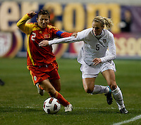 Lindsay Tarpley (5) of the USWNT fights for the ball with Liu Huana (2) of China during an international friendly at PPL Park in Chester, PA.  The U.S. tied China, 1-1.