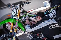 Mechanic reparing a motorbike at Spanish Motocross Championship at Albaida circuit (Spain), 22-23 February 2014