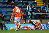 Gozie Ugwu of Wycombe Wanderers (centre) avoids the challenge of Oliver Lee of Luton Town (right) during the Sky Bet League 2 match between Wycombe Wanderers and Luton Town at Adams Park, High Wycombe, England on 6 February 2016. Photo by Claudia Nako.