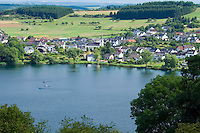 "Eifel, Germany, August 2010. There are 74 volcanic lakes in the Eifel, called a 'Maar' From the flat north near Aachen, over the ""Hohes Venn"" (or ""High Fen""), through the lonesome Rurtal, past imposing dams, the ""Eifel National Park"" and over the lime Eifel and Vulkaneifel to the Southern Eifel, the Eifelsteig passes through a wide variety of areas, constantly revealing new landscapes to hikers. 313 kilometres of the Eifelsteig - a good 300 kilometres of varied, natural tracks, with a large number of bare paths, magnificent views, and a variety of different formations. Photo by Frits Meyst/Adventure4ever.com"