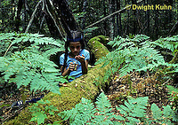 DT01-004z  Forest - girl collecting organisms from soil, log