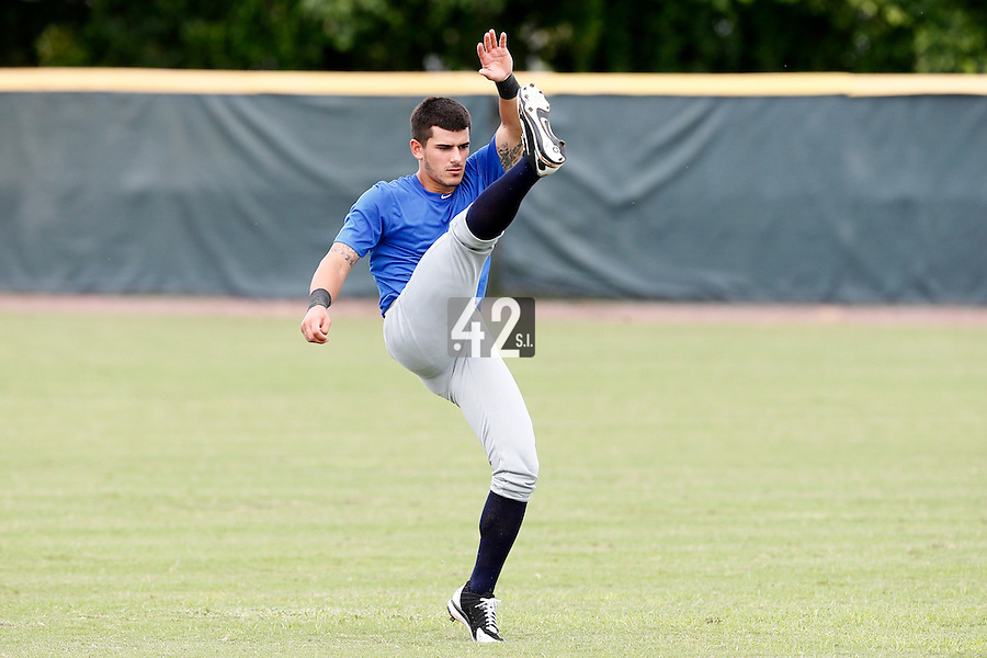 19 September 2012: France Maxime Lefevre stretches prior to Team France friendly game won 6-3 against Palm Beach State College, during the 2012 World Baseball Classic Qualifier round, in Lake Worth, Florida, USA.