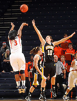 Dec. 18, 2010; Charlottesville, VA, USA; Virginia Cavaliers guard Paulisha Kellum (3) shoots over UMBC Retrievers 6-0 Meghan Colabella forward (10) during the game at the John Paul Jones Arena.  Mandatory Credit: Andrew Shurtlef