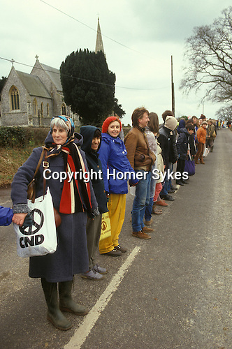 Easter CND Campaign for Nuclear Disarmament Aldermaston Berkshire 1985. People holding hands in a giant circle.