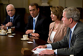United States President George W. Bush chairs a meeting on the state of the economy in the Cabinet Room of the White House in Washington, DC on September 25, 2008. Pictured, from left to right: US Senator John McCain (Republican of Arizona), the Republican Party nominee for President of the US; US House Minority Leader John Boehner (Republican of Ohio); Speaker of the US House Nancy Pelosi (Democrat of California) and President Bush. <br /> Credit: Kristoffer Tripplaar / Pool via CNP