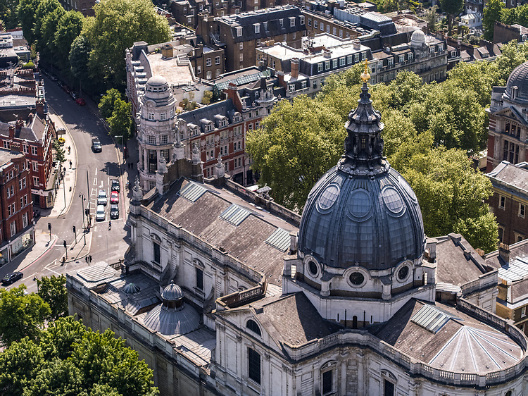 An aerial view above Kensington in London England UK with the London Oratory in the foreground with the Victoria & Albert museum with the river Thames in the background. The Church of the Immaculate Heart of Mary, better known as Brompton Oratory, is home to the Congregation of the Oratory of St Philip Neri in London, a community of priests living under the rule of life established by its founder in the sixteenth century. The Oratory also serves as a parish church in the Roman Catholic Diocese of Westminster.