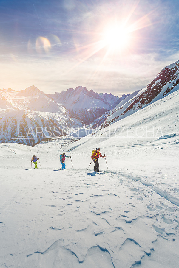 Group of skiers led by a mountain guide on the approach to Col de la Terrasse (2640m).<br /> Sustained slopes of the Loriaz Meadows offer spectacular views towards the heart of the Mont Blanc Massif.
