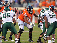 Oct 23, 2010; Charlottesville, VA, USA;  Virginia Cavaliers guard B.J. Cabbell (65) blocks during the game against the Eastern Michigan Eagles at Scott Stadium.  Virginia won 48-21. Mandatory Credit: Andrew Shurtleff