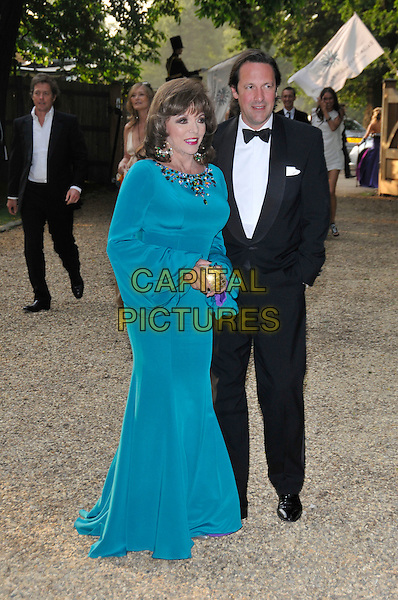 JOAN COLLINS, PERCY GIBSON.At the Russia Midsummer Fantasy, in aid of the Raisa Gobachev Foundation, Stud House, Home Park, Hampton Court, England, UK, 7th June 2008. .arrivals full length blue turquoise long maxi dress jewel encrusted gold purse black tuxedo suit bow tie earrings long sleeved sleeves.CAP/PL.©Phil Loftus/Capital Pictures