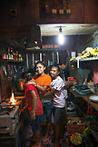 INDONESIA, Flores, young girls work in the kitchen at Lucas restaurant in Bajawa