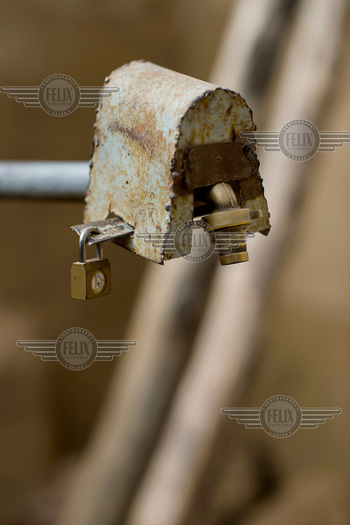 A locked water tap at a home in Zongo, an informal settlement in Burkina Faso's capital.