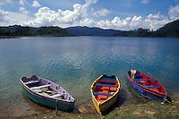 Colourful rowboats beached on the shore of Laguna Tziscao, Lagunas de Montebello National Park, Chiapas, Mexico