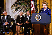 United States President George H.W. Bush awards the Presidential Medal of Freedom, the highest civilian honor awarded by the U.S., to former Prime Minister Margaret Thatcher of Great Britain in the East Room of the White House in Washington, D.C. on March 7, 1991.  From left to right: Denis Thatcher; first lady Barbara Bush, President Bush; Prime Minister Thatcher..Credit: Howard L. Sachs / CNP