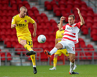 Fleetwood Town's Paddy Madden vies for possession with Doncaster Rovers' Herbie Kane<br /> <br /> Photographer David Shipman/CameraSport<br /> <br /> The EFL Sky Bet League One - Doncaster Rovers v Fleetwood Town - Saturday 6th October 2018 - Keepmoat Stadium - Doncaster<br /> <br /> World Copyright &copy; 2018 CameraSport. All rights reserved. 43 Linden Ave. Countesthorpe. Leicester. England. LE8 5PG - Tel: +44 (0) 116 277 4147 - admin@camerasport.com - www.camerasport.com