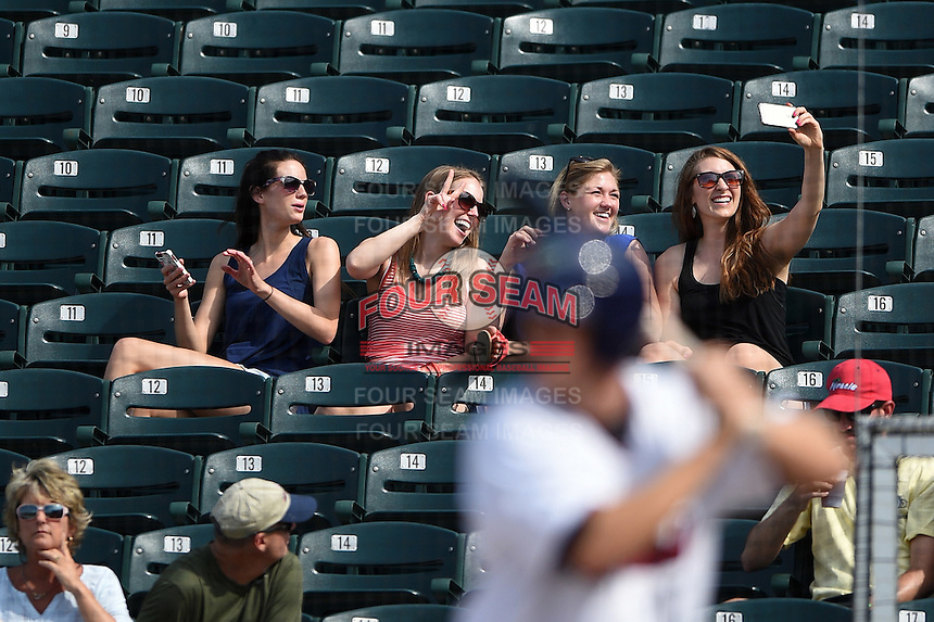 Fort Myers Miracle fans take a selfie as Alex Swim bats during a game against the St. Lucie Mets on April 19, 2015 at Hammond Stadium in Fort Myers, Florida.  Fort Myers defeated St. Lucie 3-2 in eleven innings.  (Mike Janes/Four Seam Images)