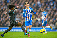 Solly March of Brighton & Hove Albion (20)  and Willian of Chelsea (22)  during the Premier League match between Brighton and Hove Albion and Chelsea at the American Express Community Stadium, Brighton and Hove, England on 20 January 2018. Photo by Edward Thomas / PRiME Media Images.